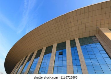 building structure of the glass curtain wall under blue sky