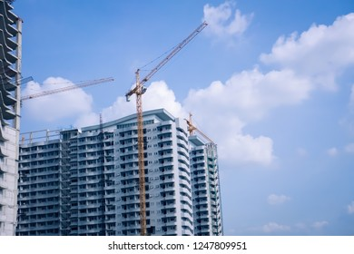 Building structures made of cement with condominium.Construction site with crane and building.The concept of creating a new address.Urban development.Business Property.Rebuilding