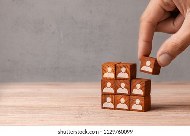 Building team. The leader builds  team from cubes with employees. Recruitment concept. Copy space for text