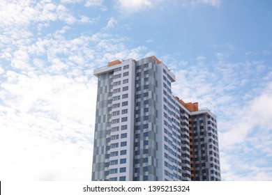 Building with tinted windows against cloudy sky. Modern architectural design