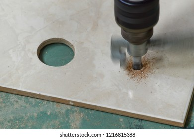 Building tools. grinder in the process of drilling tiles