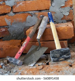 Building tools near a brick wall. Construction of the wall of the house. Tools for repair.