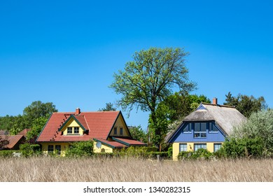 Building, trees and blue sky in Wieck, Germany.