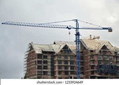 Building under construction with a crane