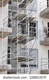 Building under construction. Scaffold structure. Industry. Vertical