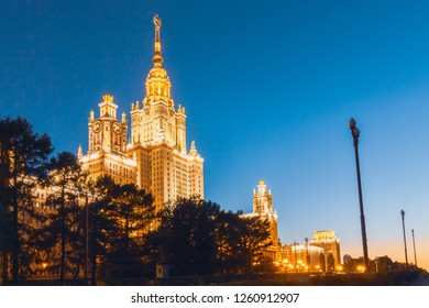The building of the University of Lomonosov, in the evening in the illumination against the blue sky