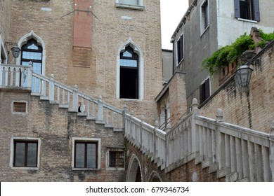 Building in Venice with arches windows and exterior staircase