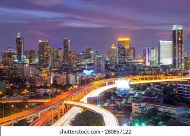Building views of Bangkok's business district and expressway.