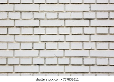 a building wall made of white brick