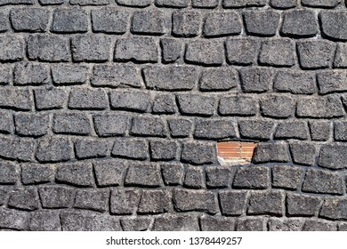 Building wall with uneven brick stones. Repair concept