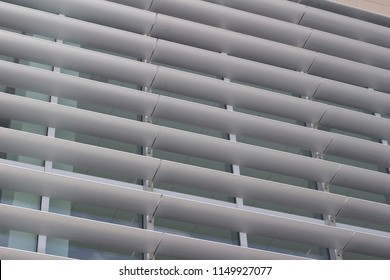 Building windows designed with with attractive energy efficient shading louvers