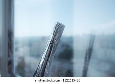 Building windows film installation process.  mirror solar protection
