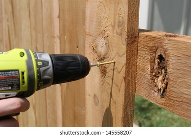 building a wooden fence with a drill and screw