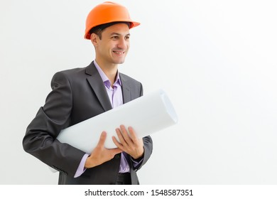 Building worker and architect discussing build drawing on construction site. industrial engineer wearing safety hard hat have meeting commercial building structure