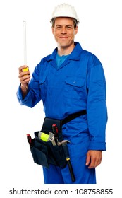 Building worker holding measuring tape isolated over white background
