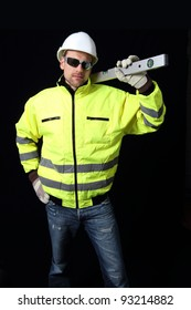 Building worker with level and glasses