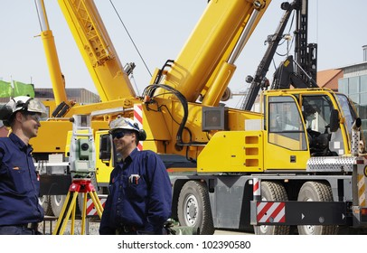 building workers with mobile cranes