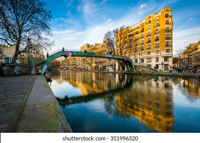 Buildings along and bridge over Canal Saint-Martin, in Paris, France.