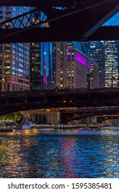 Buildings along the river Chicago illuminated at night, Chicago, Illinois, USA