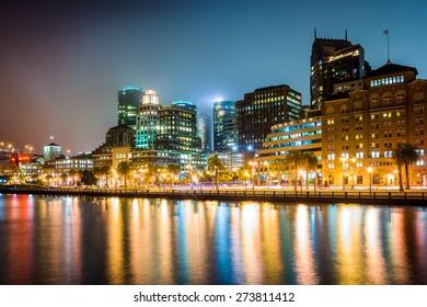 Buildings along the waterfront at night, at the Embarcadero, in San Francisco, California.