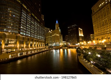The buildings and architecture of Downtown Chicago at night, by the Chicago River between The Loop and the Magnificent Mile areas.