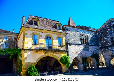 Buildings and architecture on the main square of the medieval village of Monpazier in the Dordogne region of France