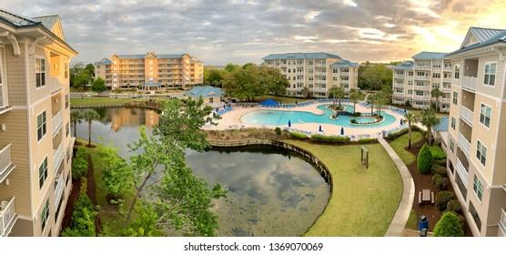 Buildings around generic swimming pool at dawn