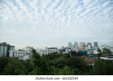 A lot of buildings and blue skies , The city is full of tall buildings and beautiful sky