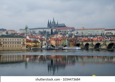buildings and bridge on other side of river vltava