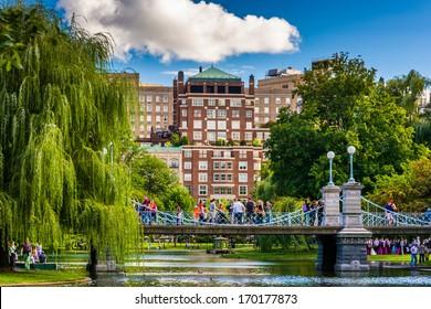 Buildings and bridge over a pond in the Boston Public Garden.