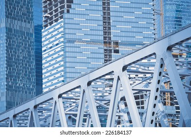 buildings and bridge under construction in the modern city.
