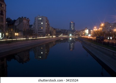 Buildings from Bucharest by night reflection on Dambovita river