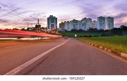Buildings and car light trails in the access road to Campinas, SP/Brazil