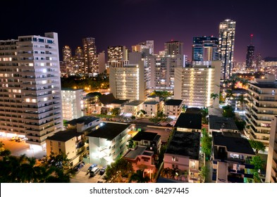 Buildings of the city of Waikiki Beach at night