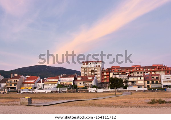Buildings at Compostela beach at dusk on Vilagarcia de Arousa