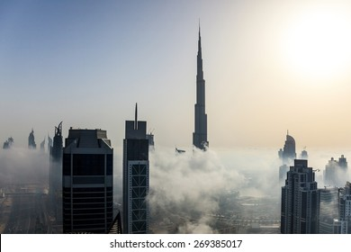 Buildings are covered in thick layer of fog in Dubai downtown.