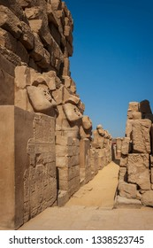 Buildings and defaced statues in the ancient city of Karnak, Egypt.