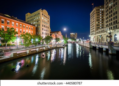 Buildings in downtown and the Providence River at night, in Providence, Rhode Island.
