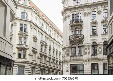 Buildings in historic old city district of Vienna Austria are decorated with wrought iron balconies and sculpted stone adornments.