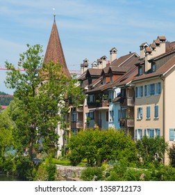 Buildings of the historical part of the town of Bremgarten along the Reuss river in summer. Bremgarten is a town in the Swiss canton of Aargau, known for its well-preserved medieval old town.