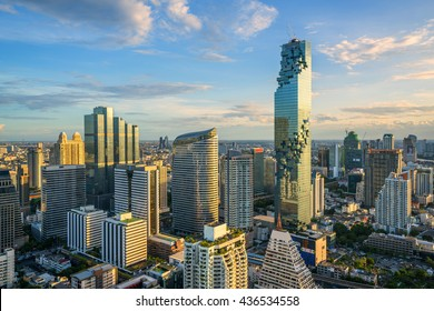 Buildings landmark of Sathorn and Silom district, This area is an important business and banking center in Bangkok. With warm sunlight effect on sunset time create highlight and shadow at building.