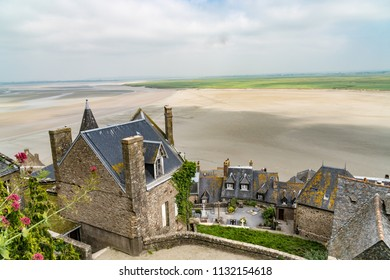 Buildings of Mont Saint Michel, an island in Brittany France. The island has held strategic fortifications since ancient times and since the 8th century AD has been the seat of the monastery.