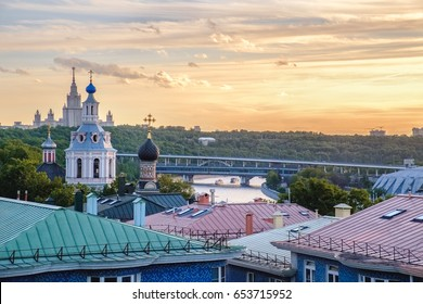 Buildings of Moscow city center at sunset with State University silhouette, classical old church and colorful Moscow roofs. Golden sunset lights above Moscow, outdoor summer evening in Moscow, Russia.