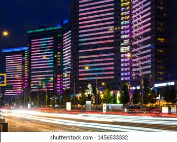 Buildings with multi-colored live illumination on New Arbat street at night in Moscow, Russia