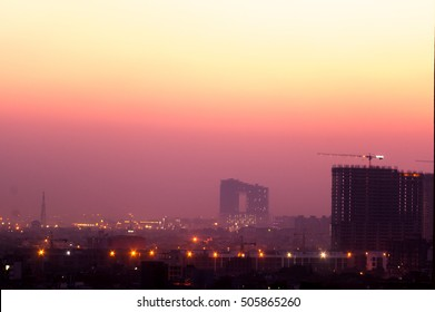 Buildings in Noida at dusk with the lights shining bright. The cityscape of noida is now being modernized with the addition of multiple skyscrapers.