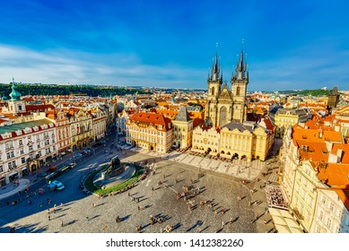 Buildings on the Old Town square Staromestska Namesti with Tyn Church in Prague, Czech Republic during summer sunny day with blue sky. Prague is the capital of Czech republic.
