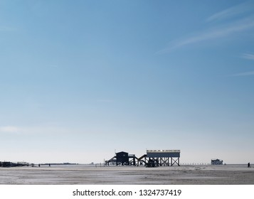 buildings on a sunny but frozen empty beach