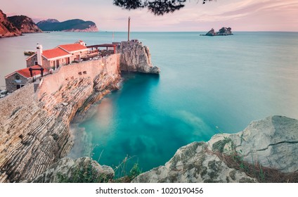 Buildings on top of a cliff in Petrovac, Montenegro.
