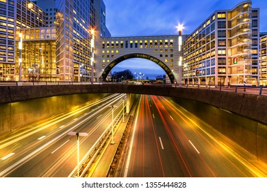 Buildings over the end of A12 highway entering inside The Hague city during the blue hours, Netherlands