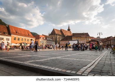Buildings and people in the main square of Brasov, Romania 20.08.2017